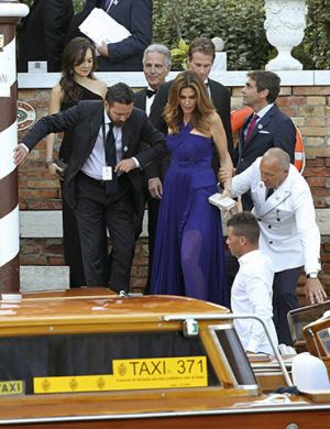 U.S. model Crawford gets help next to her husband Gerber as they board a taxi boat transporting guests to the venue of a gala dinner ahead of the official wedding ceremony of U.S. actor Clooney in Venice