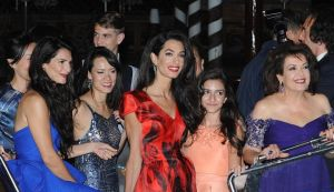 George Clooney Amal Alamuddin - the evening before the wedding Venice - red Alexander McQueen dress.jpg