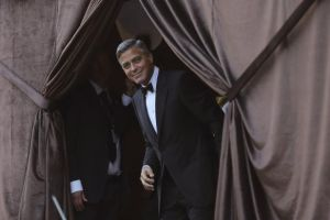 U.S. actor Clooney smiles as he arrives by taxi boat to the venue of a gala dinner ahead of his official wedding ceremony in Venice