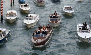 U.S. actor George Clooney travels in a taxi boat in the Grand Canal in Venice, ahead of a gala dinner