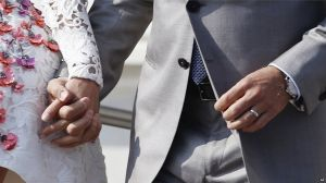 Wedding ring - George Clooney and Amal Alamuddin in floral Giambattista Valli Couture dress.jpg