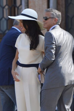 White suit and hat - George Clooney and Amal Alamuddin at the signing the official wedding register.jpg