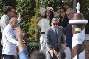 White trouser suit and hat - Amal Alamuddin at the signing the official wedding register.jpg