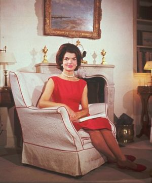 Fashion photos of Jackie Kennedy Onassis - jacqueline kennedy in red dress in armchair.jpg