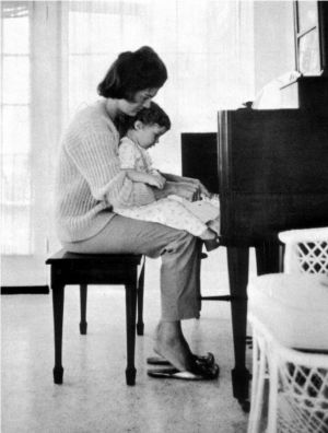 Jackie Bouvier Kennedy Onassis photos Ladylike style - jbk playing piano.jpg