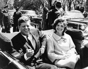 President-John-F-Kennedy and jackie bouvier kennedy onassis in the open car.jpg
