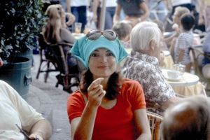 jackie bouvier kennedy onassis at a cafe with headscarf and glasses.jpg