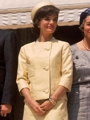 jackie bouvier kennedy onassis in pale yellow suit.jpg