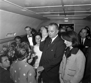 jackie bouvier kennedy onassis with johnson-swearing-in after jfk death on plane.jpg