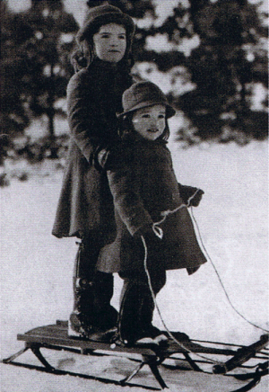 jackie bouvier kennedy onassis with sister lee in the snow as children.png