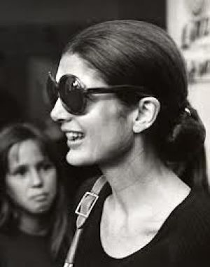 jackie bouvier kennedy onassis with slicked hair ponytail and sunglasses.jpg