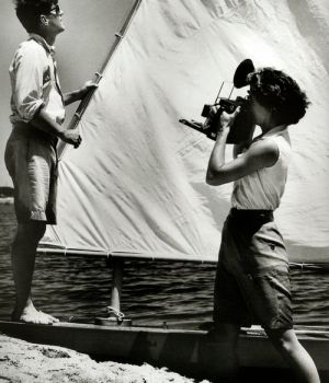 jackie bouvier kennedy taking a photo of husband john in the water.jpg