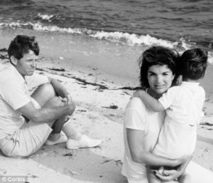 jackie bouvier kennedy with her children and robert kennedy on the beach.jpg
