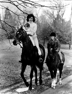 jackie bouvier kennedy with her children horseriding.jpg