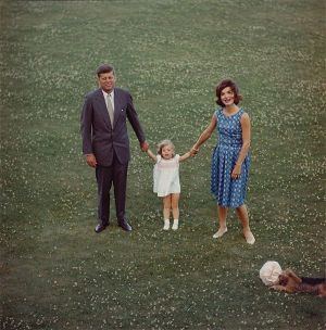 jackie bouvier kennedy with husband john and daughter caroline.jpg