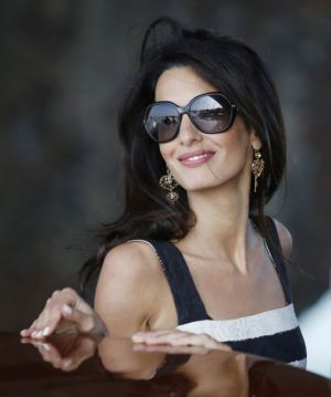 Amal Alamuddin Clooney with Dolce and Gabbana earrings and Prada sunglasses.jpg