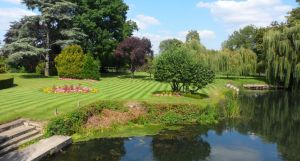Lawns and river at the nearby French Horn in Sonning.jpg
