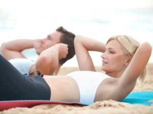 Couple exercising on beach photo - motivation for a healthy life.jpg