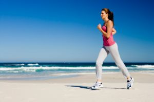 Improve your health - Woman jogging on beach - images.jpg