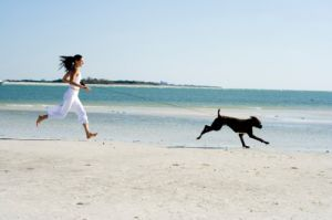 Running on the beach with dog - healthy living ideas.jpg