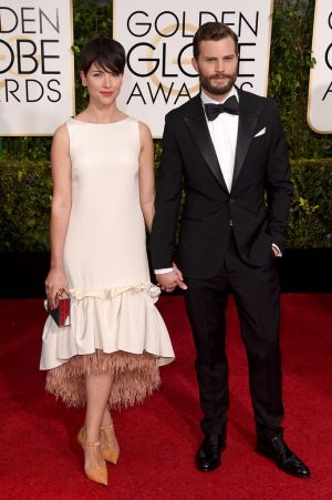 Golden Globes 2015 fashion - Amelia Warner and Jamie Dornan.jpg