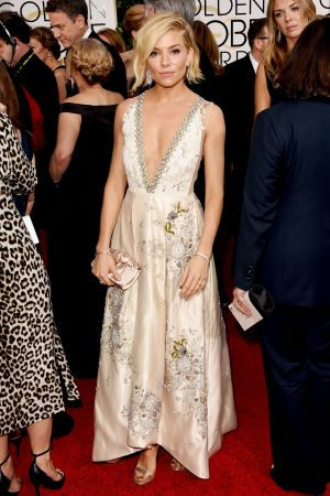 Golden Globes 2015 fashion - Sienna Miller in Miu Miu and Tiffany jewellery.jpg