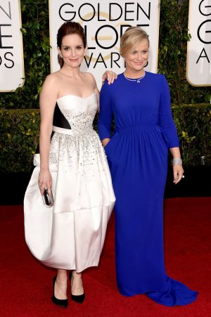 Golden Globes 2015 fashion - Tina Fey in Antonio Berardi and Amy Poehler in Stella McCartney.jpg