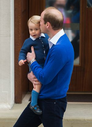A kiss from Dad - Prince George arrives to meet his baby sister.jpg