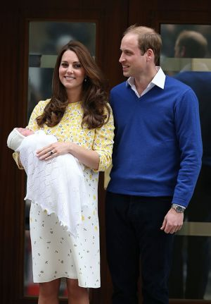 Kate with the baby princess leaving the Lindo Wing wearing a cream and yellow Jenny Packham dress.jpg