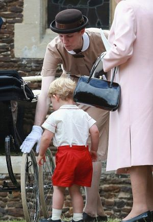 Nanny Maria Borrallo in her Norland nanny uniform with Prince George2.jpg