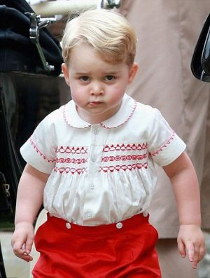 Prince George in his red-and-white tribute outfit at her sister's christening - 2015.jpg