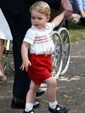 Prince George in his red-and-white tribute outfit at her sisters christening - 2015.jpg