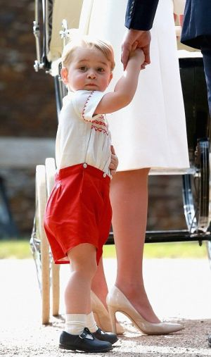 Prince George in his red-and-white tribute outfit at her sisters christening - July 2015.jpg