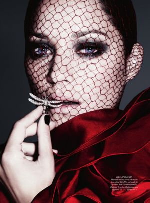 Marion Cotillard by Ben Hassett for Harpers Bazaar UK December 2012.jpg