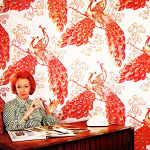 Florence Broadhurst in front of wallpaper.png
