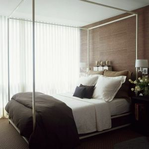 Luscious bedroom with brown accents including grasscloth wallpaper.jpg