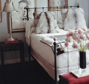 Luscious bedroom with furry cushions.jpg