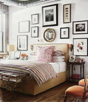 c100-Beautiful bedroom with pictures on wall.jpg