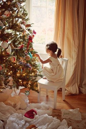 Christmas trees - mylusciouslife.com - child with christmas tree.jpg