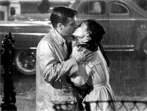 Best fashion films - Breakfast at Tiffanys - Audrey trench coat - kissing George Peppard.jpg