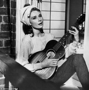 Top 10 fashion films - Breakfast at Tiffanys - Audrey guitar fire escape.jpg