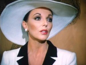 TV show fashion history - Dynasty - Alexis in white suit and hat.jpg