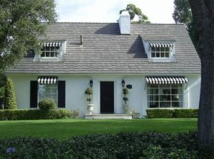 white house with black and white canopy  - mylusciouslife.com.jpg