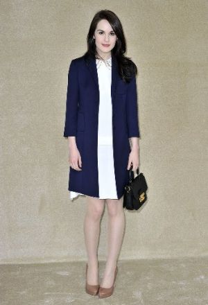 Michelle Dockery at Miu Miu Fall 2012 in Paris.jpg