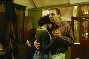 Undated publicity handout shows Whitney Houston and Kevin Costner dancing in a scene from their 1992 film