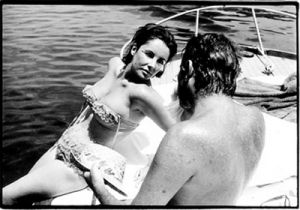 Elizabeth Taylor and Richard Burton on boat 1962.jpg
