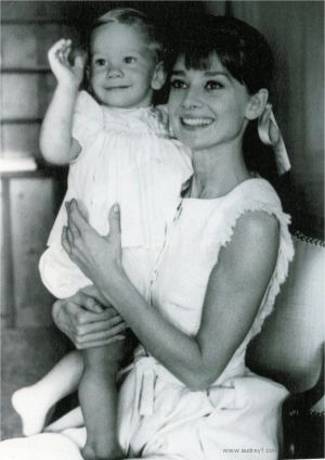 Audrey Hepburn holding child - white dress.jpg