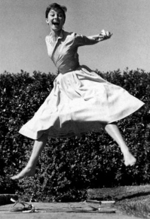 Audrey Hepburn laughing and jumping - mylusciouslife.com.jpg