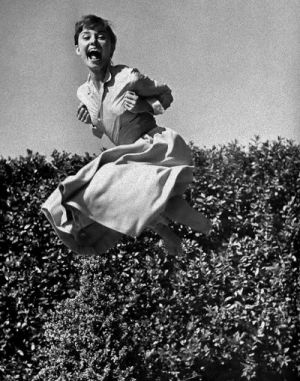 Audrey Hepburn laughing and jumping photo - mylusciouslife.com.jpg