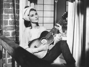 audrey-hepburn-breakfast-at-tiffanys - guitar on the fire escape.jpg